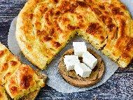 Вита баница с готови кори и плънка от яйца, брашно, кисело мляко и сирене
